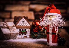 Gift for Christmas ,gingerbread house, a toy Santa Claus. Photo with copy space royalty free stock photography