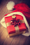 Gift in christmas hat Stock Images