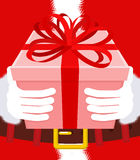 Gift on Christmas. Santa gloves and box with bow. Red tape and y Royalty Free Stock Images