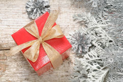 Gift for Christmas in small red box Royalty Free Stock Photography