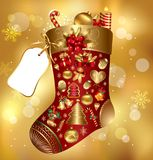 Gift Christmas sock. Decorated diferent holiday elements on blur gold background Stock Images