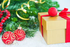 Gift with Christmas tree and balls Royalty Free Stock Image