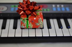 Gift close-up on synth keys with a soft blurred background royalty free stock photos