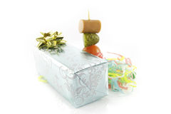 Gift with Cocktail Stick and Streamers Stock Photo