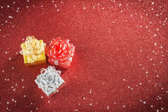 Gift. Colored gift, red glitter background Stock Images