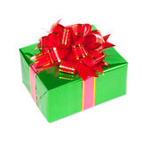 Gift in colorful package with bows. Isolated on white background Royalty Free Stock Images