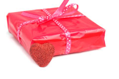 Gift concept (narrow DOF). Red gift concept with gift box and red heart (narrow DOF, focus on the heart stock photo