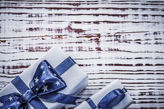 Gift containers with blue present tapes on vintage wooden board Royalty Free Stock Image