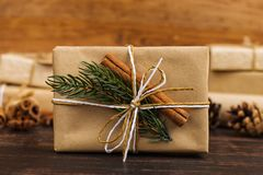 A gift of craft paper beautifully decorated for Christmas. royalty free stock images