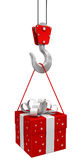 Gift on crane hook. Image with clipping path Royalty Free Stock Photography