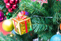 Gift on cristmas tree royalty free stock images
