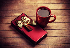 Gift and cup of coffee royalty free stock photos