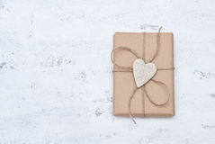Gift. Decorated with ceramic heart Royalty Free Stock Photos