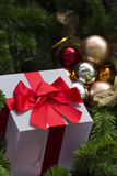 Gift and decorated christmas tree. Close up of gift and decorated christmas tree Royalty Free Stock Photos