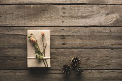 Gift decorated with dried flowers Stock Photography
