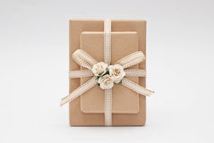 Gift. Decorated with paper flowers Royalty Free Stock Image