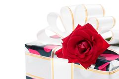 Gift decorated with ribbon and red roses Stock Photos
