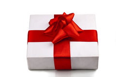 Gift decorated with a tape and a bow Royalty Free Stock Photos