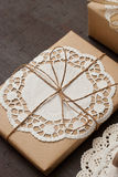 Gift. Decoration with doilies and twine Royalty Free Stock Photography