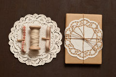 Gift. Decoration with doilies and twine Stock Photos