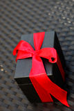 Gift with decorative red bow Royalty Free Stock Image