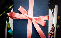 Gift with a decorative red bow Royalty Free Stock Photos