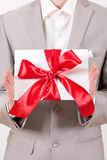 Gift with decorative red ribbon bow Stock Image