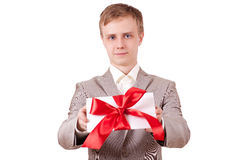 Gift with decorative red ribbon bow Stock Images