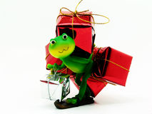 Gift delivery. Froggy carrying gifts wrapped up in shinny paper Stock Images
