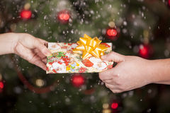 Gift delivery  between a man and a woman Stock Photography
