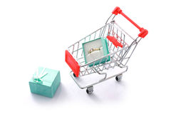 Gift diamond ring in shopping cart isolated Stock Image