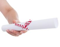 A gift diploma in hand. On white Stock Images