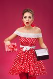 Gift disappointement. Pin-Up Retro Style Woman Royalty Free Stock Images