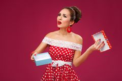 Gift disappointement. Pin-Up Retro Style Woman Stock Photo