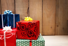 Gift dof. Colorful gift packages in front of a wooden background with shallow deoth of field Stock Image