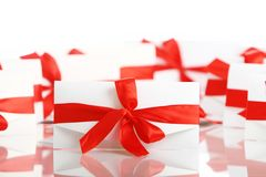 Gift envelope with awesome red bow Stock Images