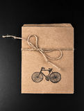 Gift envelope from craft paper. With bicycle print on the black background Royalty Free Stock Photography