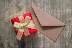 Gift and envelope on the table Stock Images
