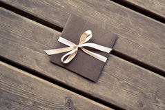Gift envelope on a wooden floor Stock Photography