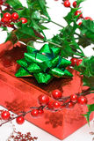 Gift with european holly Royalty Free Stock Photos