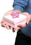 Gift in female hands. On a white background Royalty Free Stock Photography