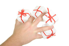 Gift between fingers. On  white background Stock Images