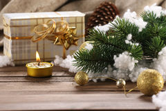 Gift, fir branch, candle, Christmas decorations Stock Photography