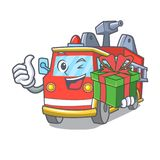 With gift fire truck mascot cartoon. Vector illustration Royalty Free Stock Images