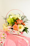 Gift and flower arrangement Stock Image