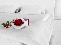 Gift with the flowers on the bed Stock Photo