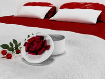 Gift with the flowers on the bed Stock Photos