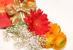 Gift and flowers bouquet Stock Photo