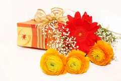 Gift and flowers bouquet Royalty Free Stock Photo