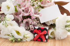 Gift and flowers Stock Photos